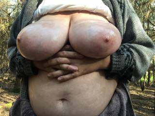On a sunny day my friend pulled her top up, oiled her lovely big tits, then supported them below