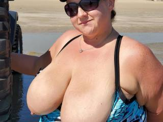 Flashing her tits turns her on. What would you do if you saw this on the public beach?