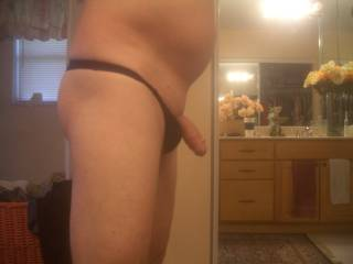 side view of my dick hanging out of my thong