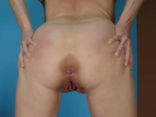 my wife spreading her virgin ass.