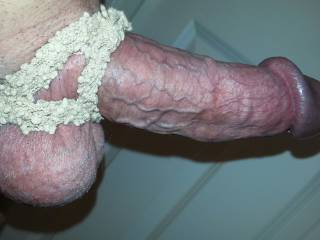 Another hair scrunchy twisted into three loops around my cock and balls