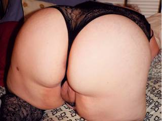 Her nice Full, Round, and Very, Very SEXY BEHIND, and PUSSY peeking out. My Beautiful Wife that let's me show off her Loveliness (because it deserves to be seen).