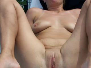 You have one of the nicest assholes I've seen, woman! I'd love to shove my swollen cock inside that tight hole of yours while you put your feet on my chest ... I would fuck your ass silly ...