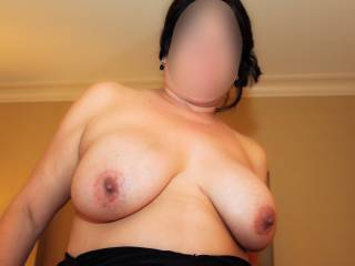 We were spending the night in a nice high rise hotel…I was topless and about to suck his cock!