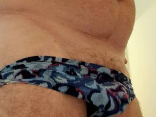 These panties feel so nice.  Smooth fabric containing my horny cock.