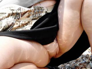 My submissive with a commando upskirt on her local Sussex beach