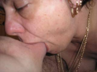 she\'s sucking my balls right in and flicking with her tongue
