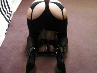 The wife in her spanking skirt in uncompfortable bondage