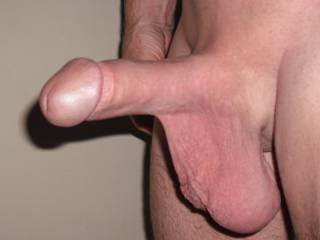My smooth shaven thick cut cock and big low hanging balls.