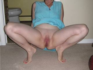 wife squating down for full spread view hope you enjoy.