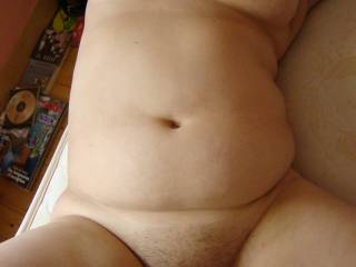 Wow she has a body built for comfort doesn't she?  Love those big soft boobs, her belly and that furry pussy between her plump thighs.  I'd give her a very thorough servicing.