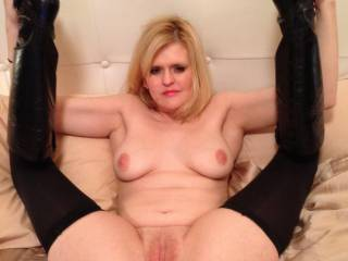 By far my favorite. Omg your so hot and inviting. This entire pic says come give you tons of pleasure and give it to you now. Hard !! Your so sexual and to see you like this drives me crazy. I wanna walk in your room and take you like this . I wanna look up at you as I eat you up and watch you orgasm. Then see your face as my cock enters you slowly at first and then hard as you buck your hips and moan with pleasure feeling your walls contract with pleasure as your gorgeous pussy engulfs my cock. Your wetness soaking all of me.