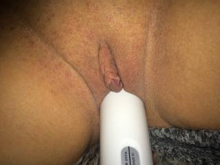 She loves the feeling of the fat wand filling her wet pussy...