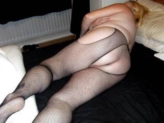 Your favourite bbw slut posing in fishnets showing my ass. Tell me would you fuck me?