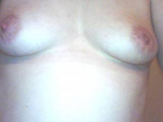 wifes sweet tities!!let us know what ya think!