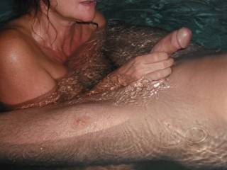 Playing with his lovely smooth thick cut cock in the spa at home.