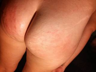 She was naughty so I spanked her ass quite well. Notice the welts on the left ass cheek! She got a hard pounding while being spanked...