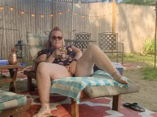 Wife teasing with her pussy in the back yard