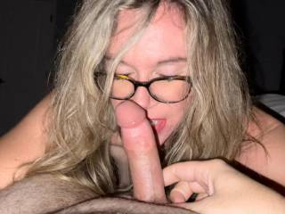 Wifey taking a breather while sucking some more cock