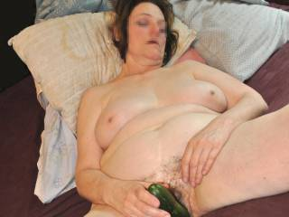 Beautybird enjoying a huge cucumber! Working it in and out... she gets it in about 10 inches deep and strokes it in and out fast.. then cums with it bumping the bottom of her cunt... OUTRAGEOUS! She LOVES IT!
