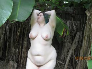 My lovely wife posing for the camera during her naked walk outside on our back property.