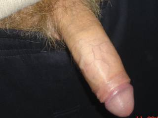 That is a beautiful uncut cock that I'd love to suck and swallow.  MILF K
