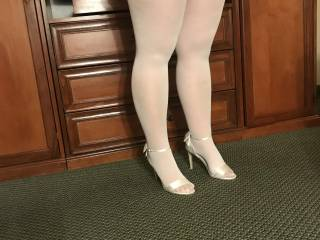 Sexy looking woman in some beautiful looking high heels and white stockings.