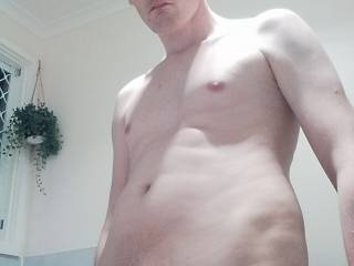 My uncircumsized cock became hard when I looked at my cock and its long foreskin
