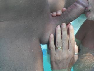 Sucking his lovely smooth thick cut cock in the swimming pool at home.