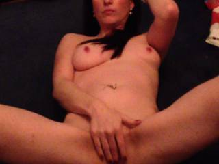 Naked & playing with her pussy