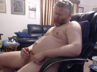 im Masturbation at home sitting in a chair