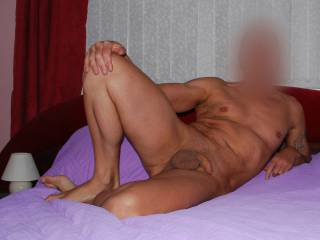 A shot taken in my bedroom, a sort of tasteful shot, if it can be described as that given that I am showing my cock. At least I am not erect, so it is tasteful. Let me know if there is a different way that I should pose in.