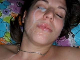 And we love seeing it on your prety face.  Amazing load on this sexy lady.  Gotta love a girl who loves it on her face. Very hot pic.