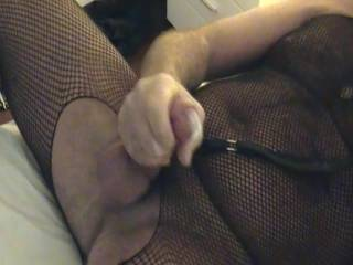 Debbie films as I jerk off in my body stocking with my cock leach on. This thing is called the jerk and can be a lot of fun. I like to hand it to my partner and let them pull me around by my cock and balls. you want to try?