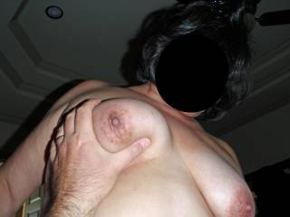 Hubby's got a grip on my tit, while off camera I am stroking his cock...I win!