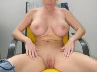 ME! I want to kiss,lick and suck your beautiful pussy while you sit in that chair and make you cum so much you slide right out of it onto the floor where I'll continue to suck your swollen clit and straddle your gorgeous face and shove my big.thick,rock hard cock into your sexy mouth and face fuck you! Every time you cum you'll try to take my cock deeper down your throat! Eventually you'll feel the veins in my thick shaft pop out more and it gets even more rigid and my big cockhead swells a little more just before I shove it harder and deeper down your sexy throat and pump the biggest,hottest and sweetest tasting load of fresh squeezed cum into your belly,choking you with each pulse and squirt of cum! All the while you're still cumming on my face which is still buried in your magnificent pussy,sucking your engorged clit! It's alot of cum but you get it all down,moaning with satisfaction the whole time,cumming and sucking every last drop of my sweet cum from my balls and I lap up every last drop of your sweet pussy juice. We lie there,completely drained and completely satisfied. From behind you I wrap my arms around you and squeeze your beautiful,huge tits! While holding your magnificent mammeries in my hands (I have big hands) I roll your big,hard nipples between my thumb and forefinger like a big,juicy grape! Your gorgeous body begins to squirm. My cock,which is between your sexy cheeks starts growing and getting harder! I roll you on your back and slap my cock between your huge tits and you squeeze those big beauties around the thick,hard shaft! I start sliding my cock back and forth,the big head poking out under your chin.....