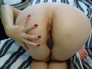 Wow what an ass and waht a pussy & ass - just ready for taking.  Pass me that big tube of lube!!  Or get your guy t creampie you & then I'll use that as my lube! How naughty is that!  Loving the nicely manicured nails by the way.  Makes you look elegant, yet wickedly sexualised all in one shot.