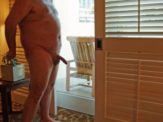 Weekend getaway at a luxury resort. Hubby patiently posing for some nude pics before I gave him a blowjob...and some pussy!  Hubby was being watched very closely by a couple of female golfers standing outside about 10 feet from the sliding glass door!
