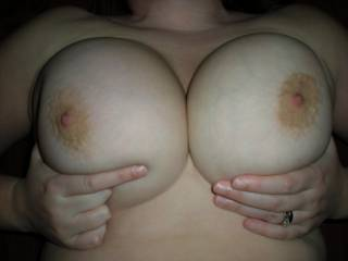 Wife loves showing off her huge breasts.