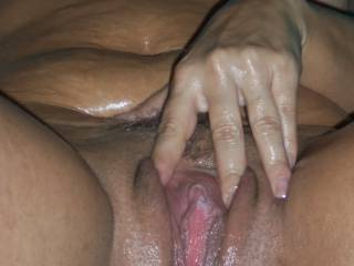 Rubbing and spreading my wet oily pussy for you to slide in.