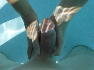 Playing with his semi-hard cock in the swimming pool at home. I love to feel it hardening up ready to fill me up.