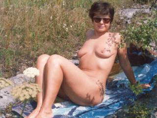 She is enjoying sun in public park in a discrete place where there are not meny visitors. However ...