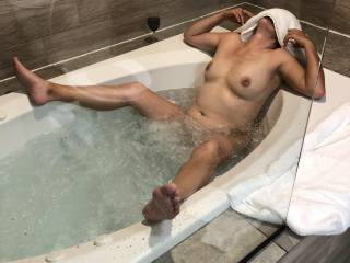 Legs spread, a glass of wine, feeling good anyone want to go under water