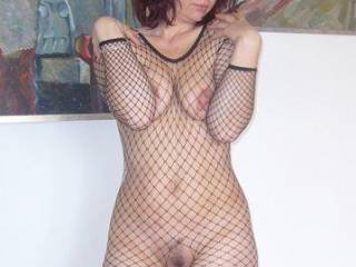 Wow!  Beautiful and very sexy body!!  Love the fish nets and opening to you sweet, trimmed pussy...yum!!