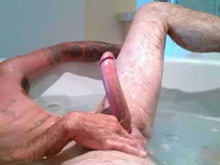 Dick rock hard in the hot tub