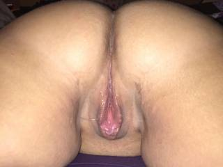 Hubby had me lay on the bed on my stomach and began rubbing and kissing on my back and legs working my way to tease my inner thighs. By the time he got to my pussy, I was dripping wet... mmm!! He ran his tongue all over my clit, my pussy and my ass.
