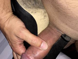 Rubbing his dick against her heels. Do you like footjobs?