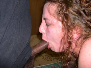Cleaning her cum off a black cock at her gangbang