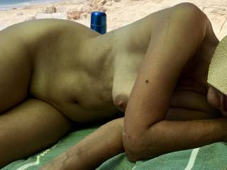My nudist wife with her lovely tits out for all the horny guys to see. What a turn on for me. Would you fuck her?