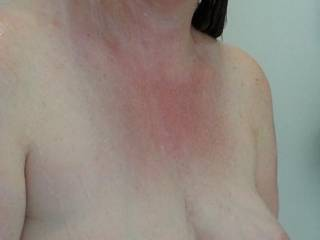 Heavy milk filled lactating breasts hanging in the shower